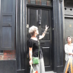 Tour guide Rachel Kosky highlights a mezuzah in the doorway of a Jewish house. Photo: Seema Rampersad